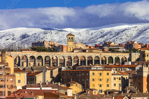 view of Segovia with roma aqueduct and mountains
