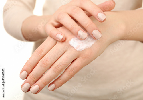 Staande foto Manicure Female applying cream on her hand, closeup