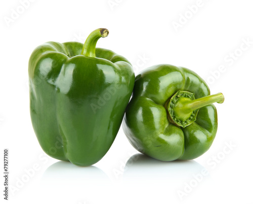 Carta da parati Close-up shot of two green bell peppers isolated on white