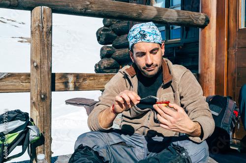 Fényképezés  Young hiker having a snack