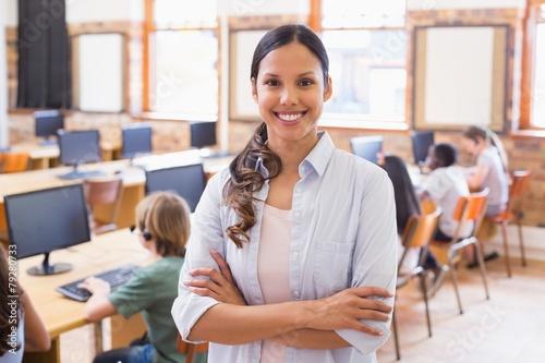 Valokuva Pretty teacher smiling at camera at back of classroom