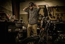 Mechanic Preparing Ford Lathe Works In Motorcycle Customs Garage
