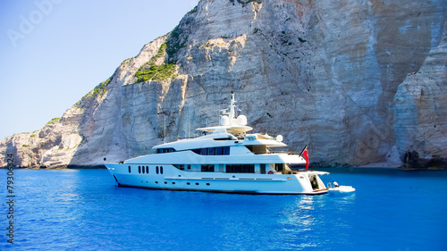 Luxury white yacht navigates into beautiful blue water near Zaky Fototapeta