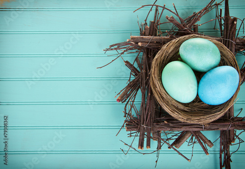 Photo  Dyed Easter eggs in a nest