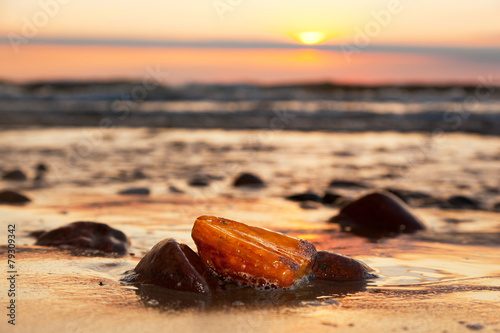 Fotografija Amber stone on the beach. Precious gem, treasure. Baltic Sea