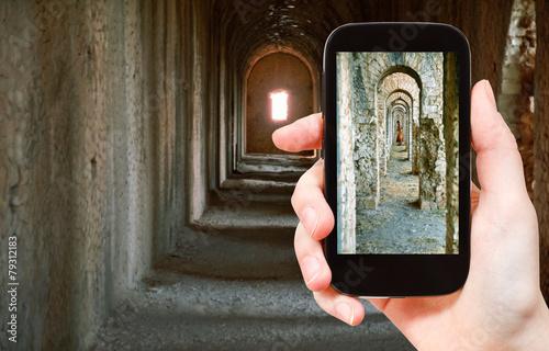 Valokuva  tourist taking photo of ancient arcades in Temple