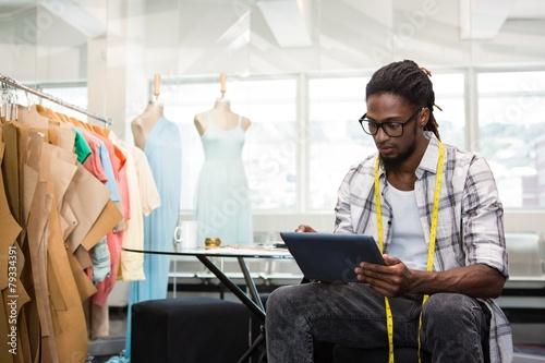 Fashion designer using digital tablet Fototapeta