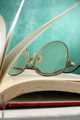 Fototapety, obrazy: open page at glasses resting on the book