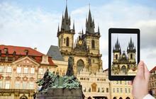 Tourist Taking Photo Of Church In Prague