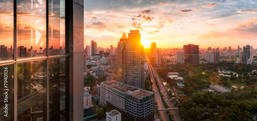 Bangkok city sunlight warm orange panorama, dawntime sunrise in morning rooftop view, the office buildings in Bangkok city skyline top view business office in capital city of Thailand Asian