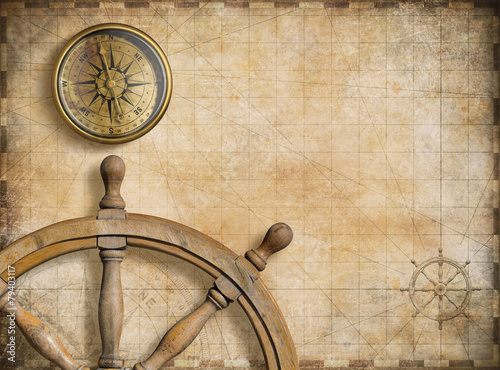 Canvas Prints Ship steering wheel and compass with vintage nautical map
