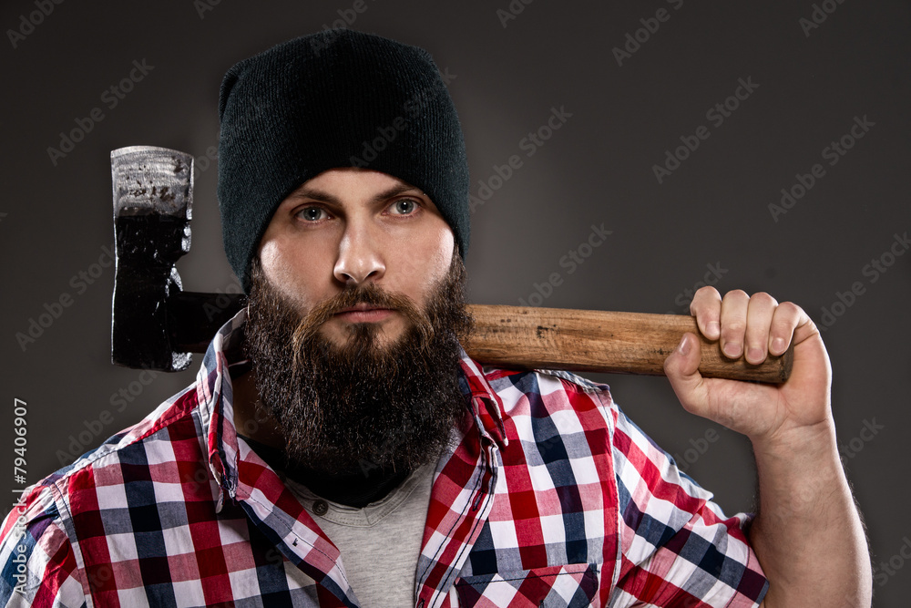 4a63c9b9 Fotografiet, Poster Confident young bearded lumberjack man carrying an axe  på Europosters.se