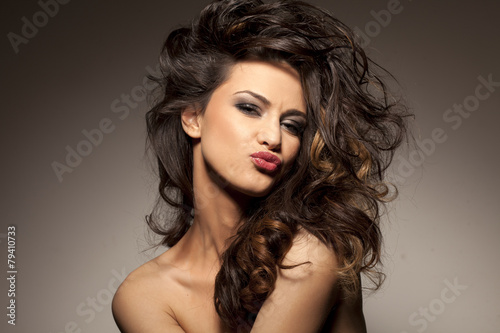 Fotografie, Obraz  marvelous beautiful brunette posing in the studio - hair styling