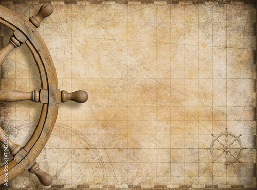 Photo Stands Ship steering wheel and blank vintage nautical map background