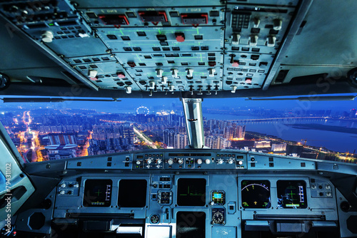 plane cockpit and city of night Fotobehang