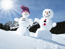 Two Funny Snowmen In The Alps