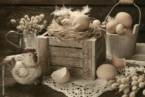 Deurstickers Retro old rustic still life with eggs in nest on wooden box for easter
