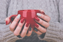 Woman With Manicured Nails Hol...
