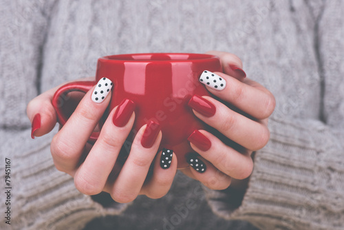 Deurstickers Manicure Woman with manicured nails holding a cup