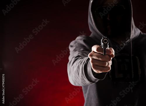 Killer with gun close-up Canvas Print