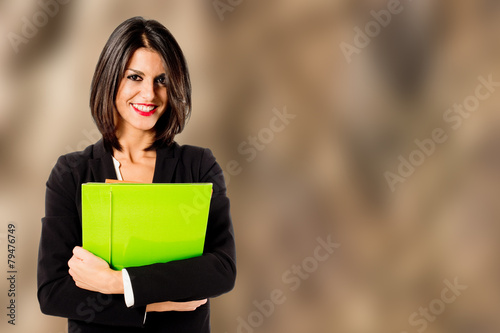Fotografia  smiling professional woman on brown background