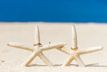 Wedding Rings On Sand And Starfish, Outdoor Beach Wedding