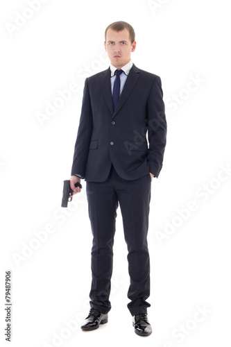 Fotografie, Obraz  full length portrait of man in business suit with gun isolated o