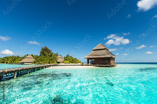 Beach Villas on small tropical island Poster