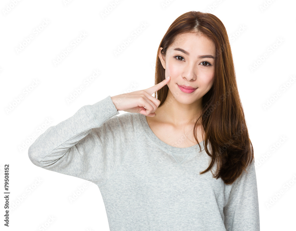 Valokuva  Asian woman with finger point to her dimples