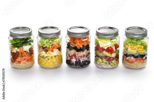 Fotografía  vegetable salad in glass jar, white background