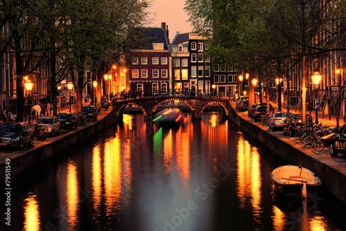 Canvas Prints Amsterdam Canals of Amsterdam with bridge lit at night, Netherlands