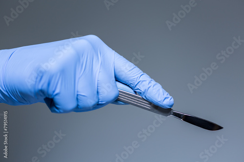 Close-up of scalpel in the hand of doctor Canvas Print