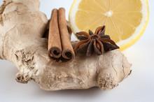 Ginger, Cinnamon, Star Anise And Lemon On White Background