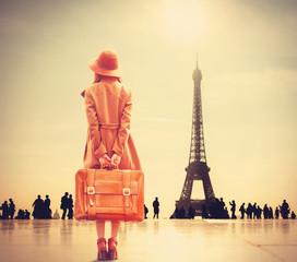 Fototapeta na wymiar Redhead girl with suitcase