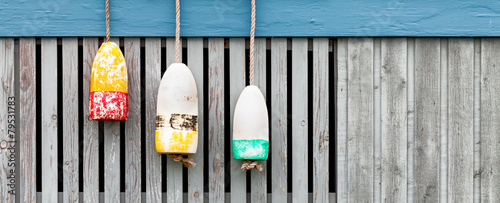 lobster buoys on weathered wood fence. Banner format Canvas Print