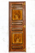 Moroccan Antique Painted Door In A White Plaster Wall