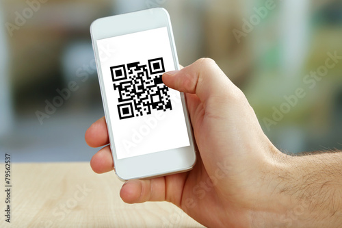 Fotografie, Obraz  Hand holding smartphone with QR code on the screen