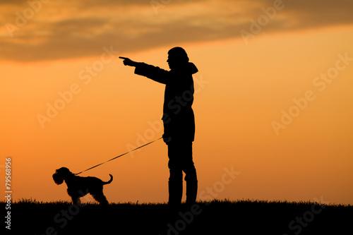 Foto op Aluminium Jacht Silhouette of man and dog