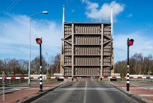 Opened drawbridge across a canal Canvas Print
