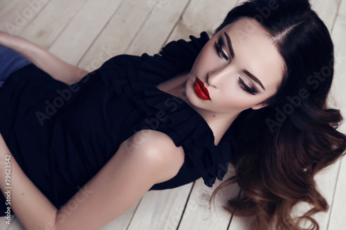 beautiful sexy woman with dark hair and bright makeup Plakat