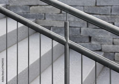 Fotografiet Edelstahlgeländer an Granittreppe mit unscharfem Hintergrund