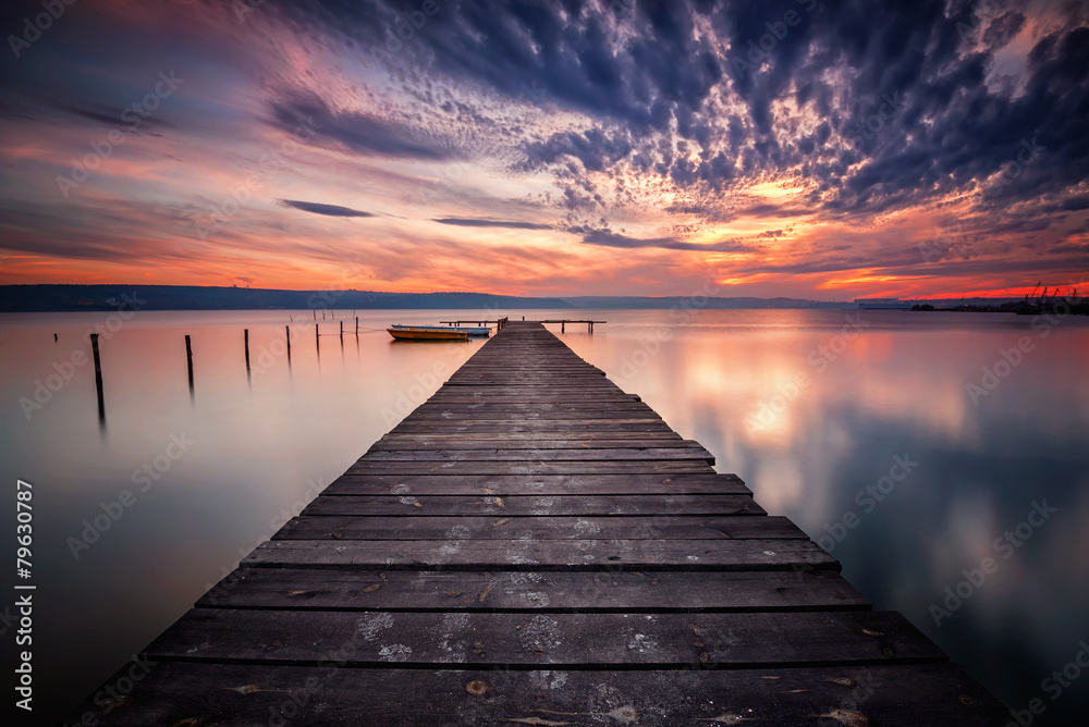 Fototapeta Magnificent lake sunset with boats and a wooden pier