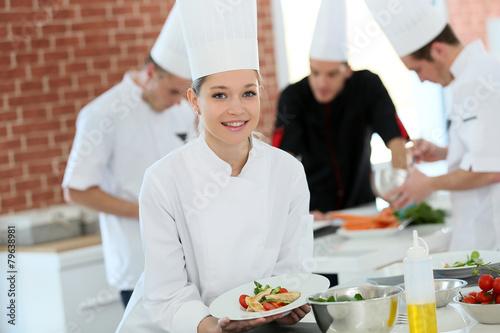 Carta da parati Portrait of student girl in cooking training course