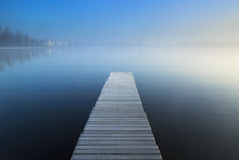 Empty Jetty In A Foggy Lake Du...