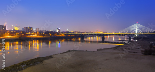Panorama of Warsaw at night with reflection in Vistula river #79640971