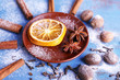 Cinnamon sticks, dried orange, star anise, nutmeg and cloves