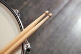 Drum sticks lay on an drum set