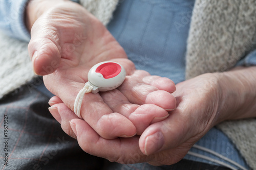 Photo  Elderly person with emergency button