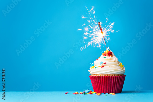 Cupcake with sparkler on blue Canvas Print