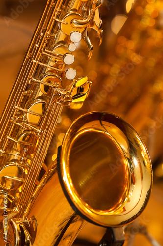 Fragment of the saxophone in golden tones Canvas Print